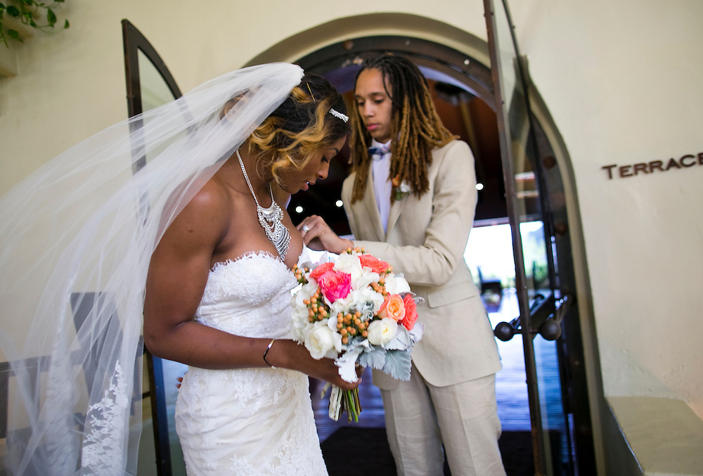 WNBA stars Glory Johnson, left and Brittney Griner leave their wedding ceremony to go the reception at the Pointe Hilton Tapatio Cliffs Resort in Phoenix, Ariz. on May 8, 2015.