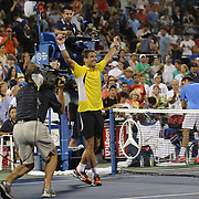 Tommy Robredo, Spain, celebrates victory over Roger Federer, Switzerland, on Louis Armstrong Stadium during the Men's Singles competition at the US Open. Flushing. New York, USA. 2nd September 2013. Photo Tim Clayton