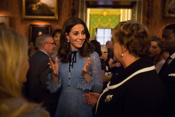 The Duchess of Cambridge attends a reception on World Mental Health Day at Buckingham Palace, London, to celebrate the contribution of those working in the mental health sector across the UK.