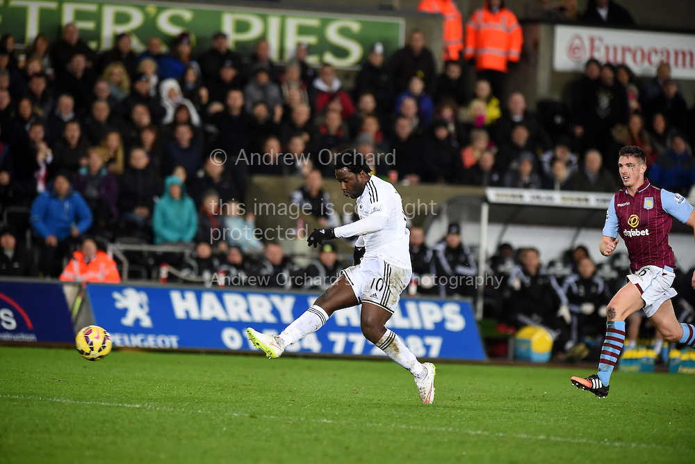 Wilfried Bony of Swansea city 'scores' a 2nd half goal but it is disallowed. Barclays Premier league match, Swansea city v Aston Villa at the Liberty stadium in Swansea, South Wales on Boxing Day, Friday 26th December 2014<br /> pic by Andrew Orchard, Andrew Orchard sports photography.