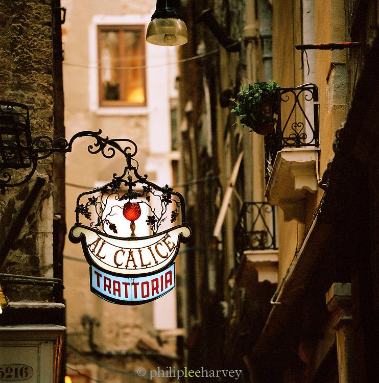 A local trattoria sign in Venice, Italy