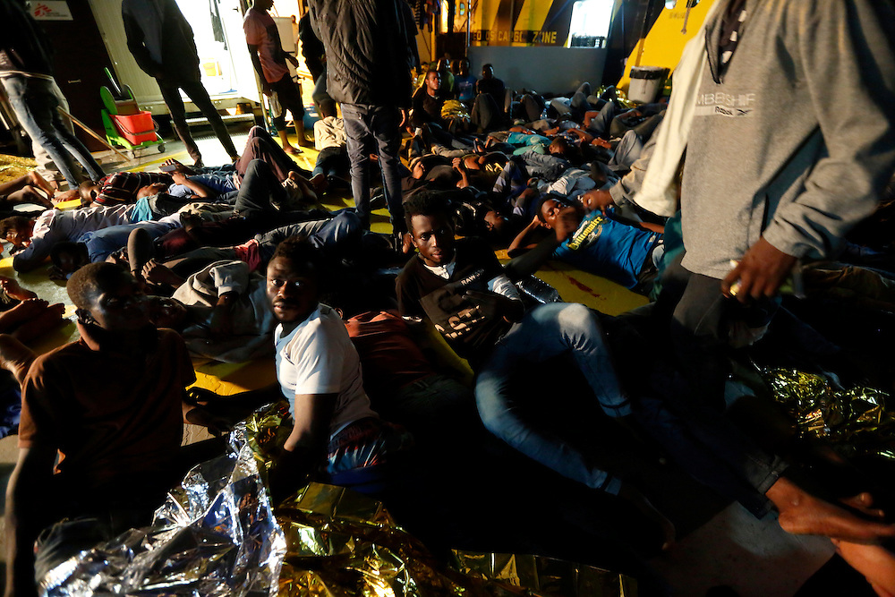Migrants prepare for a night's sleep on the deck of the Medecins san Frontiere (MSF) ship Bourbon Argos off the coast of Libya August 7, 2015.  Some 241 mostly West African migrants on the ship are expected to arrive on the Italian island of Sicily on Sunday, according to MSF.<br /> REUTERS/Darrin Zammit Lupi <br /> MALTA OUT. NO COMMERCIAL OR EDITORIAL SALES IN MALTA