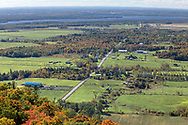 The view from the Champlain Lookout - Chemin de la Montagne heads west toward Heyworth, Quebec and the Ottawa River. Photographed from the Champlain Lookout at Gatineau Park in Chelsea, Québec, Canada. The Champlain Lookout is located on the edge of the Eardley Escarpment which is the dividing line between the Canadian Shield and the St. Lawrence Lowlands.