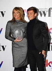 Tom Daley presented Gabby Logan with the NEP UK presenter award at the Women in Film & TV Awards at the Hilton hotel in central London.