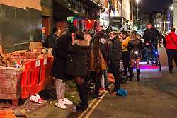 London, January 01 2018. A couple kiss outside G-A-Y on Old Compton Street as revellers in London's West End enjoy New Year's Eve. © SWNS