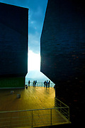 Visitors enjoy the view from the Biblioteca Espana, a library and park that has transformed the once dangerous  steep hillside barriio of Santo Domingo in Medellin, Colombia.  The library consists of three giant black geometric buildings that look like rocks rising out of the hillside.