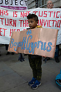 A young boy holds a placard as womens rights protesters gather outside the Cypriot Embassy in protest and support of a 19-year-old British woman who has been convicted of falsely claiming that she was raped in a hotel in Ayia Napa by 12 Israeli men in the summer of 2019, on 6th January 2020 in London, England, United Kingdom. The case has caused outrage in the U.K. with #IBelieveHer and #BoycottCyprus being used on social media. She is due to be sentenced on 7th January.