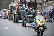 Farmers in tractors take part in a protest over food and farming standards in London on Monday, Oct 12, 2020. (VXP Photo/ Gio Strondl)