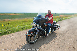 American Motordrome Wall of Death rider Wahl E. Walker takes the back roads north of Sturgis to the Broken Spoke County Line during the Sturgis Black Hills Motorcycle Rally. SD, USA. August 4, 2014.  Photography ©2014 Michael Lichter.