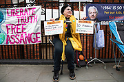 Protester outside the Ecuadorian Embassy on 5th April 2019 in London, England, United Kingdom. Wikileaks has announced that their founder Julian Assange may be expelled from the Embassy within hours or days.