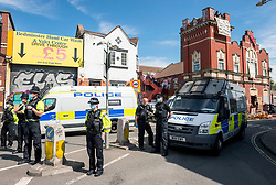 © Licensed to London News Pictures; 04/06/2021; Bristol, UK. Police mount a major operation to enter the former Salvation Army building on Dean Lane in Bedminster which has been squatted and arrested 3 people suspected of criminal activity connected with the squatted occupation of buildings in High Street in Bristol city centre which was repossessed earlier this morning by Bailiffs accompanied by around 100 police, but those occupying the buildings in High Street had already left. Those arrested at the Salvation Army building are a 40-year-old man on suspicion of assaulting an emergency worker and escaping lawful custody, a 26-year-old man on suspicion of assaulting an emergency worker and escaping lawful custody, and a woman on suspicion of affray. Police were not evicting the Salvation Army building on Dean Lane as they do not have powers to do so. Photo credit: Simon Chapman/LNP.