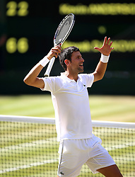 Novak Djokovic celebrates winning the Gentlemen's Singles Final against Kevin Anderson on day thirteen of the Wimbledon Championships at the All England Lawn Tennis and Croquet Club, Wimbledon.
