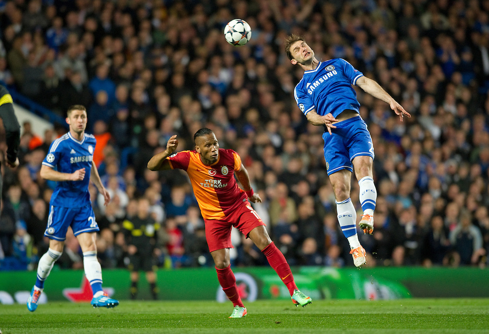 Chelsea's Branislav Ivanovic beats Galatasaray's Didier Drogba to the ball<br /> <br /> Photo by Ashley Western/CameraSport<br /> <br /> Football - UEFA Champions League First Knockout Round 2nd Leg - Chelsea v Galatasaray - Tuesday 18th March 2014 - Stamford Bridge - London<br />  <br /> © CameraSport - 43 Linden Ave. Countesthorpe. Leicester. England. LE8 5PG - Tel: +44 (0) 116 277 4147 - admin@camerasport.com - www.camerasport.com