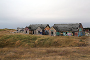 Graffiti-covered houses at Pirou-Plage, Normandy