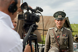 A re-enactor portraying a German officer with the rank of Captain is interviewed by local news crew about the first Annual Lytham 1940s Weekend celebrates the 70th anniversary of the battle of Britain and helps to raise funds for a new Fighter and Bomber Command Memorial. 21 August 2010 .Images © Paul David Drabble..