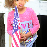 A young Pittsburgher waits for the arrival of Vice President Joe Biden as he walks the parade route in the Allegheny County Labor Day Parade in Pittsburgh on September 7, 2015.  Photo by Archie Carpenter/UPI