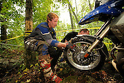 Eventual winner Brad ? pulls front wheel of R1200GS over rock obstacle while Kevin ? (black) assists.