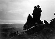 Group of Hopi Indians looking into the distance at valley floor,1905. Photograph by Edward Curtis (1868-1952).