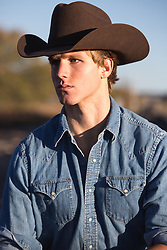 portrait of a handsome All American cowboy outdoors