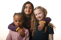 Group portrait of three young girls,