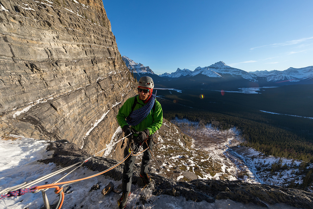 Quentin Roberts rappelling the ice climb Oh Le Tabernac in Banff National Park