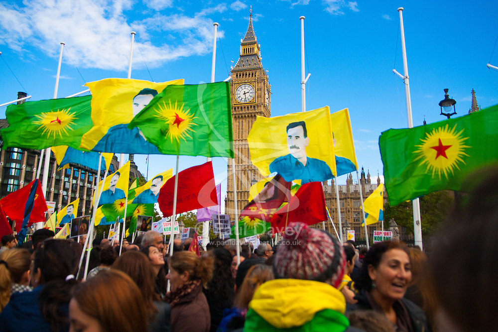 London, October 11th 2014. Thousands of protesters from the UK's Kurdish community demonstrate in London against the delay in assisting the people of the Syrian city of Kobane in their fight against ISIS. They also accuse Turkey, with whom the Kurds have had a long-running insurgency of siding with the Islamic State by doing nothing to help Kurds in Kobane. PICTURED: Kurdish protesters gathered in Parliament Square.