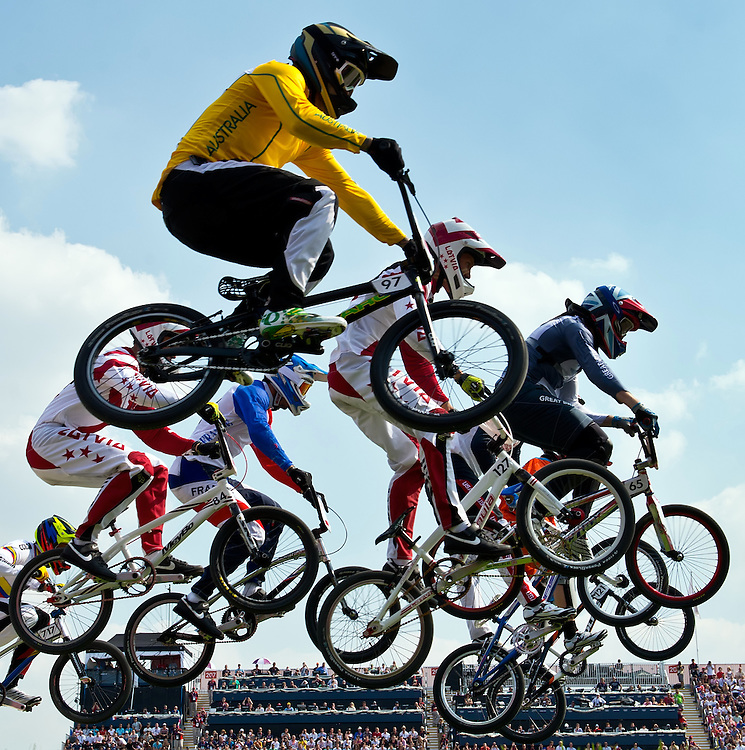Riders in the men's BMX semifinal, including Khalen Young of Australia, top center, flew over a jump at the BMX Track in Olympic Park during the 2012 Summer Olympic Games in London, England, Friday, August 10, 2012. (David Eulitt/Kansas City Star/MCT)