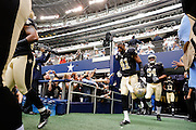 New Orleans Saints strong safety Roman Harper (41) runs onto the field before taking on the Dallas Cowboys at Cowboys Stadium in Arlington, Texas, on December 23, 2012.  (Stan Olszewski/The Dallas Morning News)