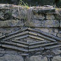 Rock patterns, possibly symbolizing jaguar eyes, adorn a wall at Kuelap, a stronghold of the pre-Incan Chachapoyan culture that dominated northern Peru about 600 years ago.