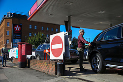 © Licensed to London News Pictures. 03/10/2021. London, UK. A man fills his car with diesel at Tesco petrol station in north London as the fuel crisis continues. The petrol station has run out of petrol and has limited supply of diesel, which will last until 2pm today. From tomorrow (4 October) military personnel, including 100 drivers, will start fuel deliveries.  Photo credit: Dinendra Haria/LNP