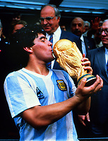 Football - 1986 World Cup Final  : Argentina 3 West Germany 2  29/06/1986<br /> <br /> Diego Maradona of Argentina kisses the trophy. <br /> <br /> Credit : Colorsport