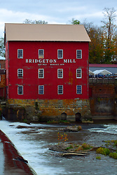 24 October 2017:  The Bridgeton Mill.  Water from a recent rain saturates the falls under the bridge as fall colored trees are in abundance.<br /> <br />  Parke County Indiana is the site of the Indiana Covered Bridge Festival every October