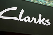 Sign for the brand and shoe shop Clarks in Birmingham, United Kingdom.