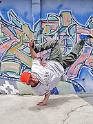 Portrait of a dancing breakdancer at street