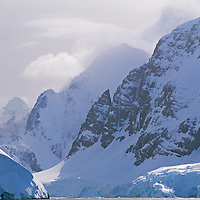 """ANTARCTICA. Mountains above Lemaire Channel, a top tourism destination separating the Antarctic Peninsula (lower left) from Booth Island, (background and right), which is often called """"Kodak Gap."""""""
