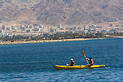 rowing in a Kayak in Eilat Eilat, pop. 55,000, is Israel's southernmost city in the Southern District of Israel. Adjacent to the Egyptian city of Taba and Jordanian port city of Aqaba, Eilat is located at the northern tip of the Gulf of Aqaba, which is the eastern sleeve of the Red Sea.