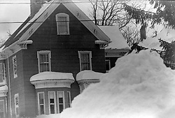 February 5, 2018 - Somerville, Massachusetts, U.S - The Great Blizzard of 1978 lasted two days in Boston on February 5 and 6. The after effects continued for two weeks with a ban on driving, work and school shutdowns and the National Guard on patrol...In Somerville, Massachusetts, a snow pile covers the sidewalk in front of a home on School Street in the Winter Hill neighborhood. (Credit Image: © Kenneth Martin via ZUMA Wire)