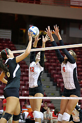 30 August 2011: Keley Augustine battles with Emily Schneider and Brooklyn Hlafka during an NCAA volleyball match between the Cougars of Southern Illinois Edwardsville and the Illinois State Redbirds at Redbird Arena in Normal Illinois.