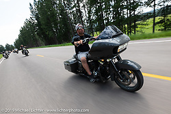 Riding a bagger on the Cycle Source ride down Vanocker Canyon back from Nemo to the Iron Horst Saloon during the Sturgis Black Hills Motorcycle Rally. SD, USA. Wednesday, August 7, 2019. Photography ©2019 Michael Lichter.