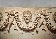 """Close up picture of Roman relief sculpted Sarcophagus of Garlands, 2nd century AD, Perge. This type of sarcophagus is described as a """"Pamphylia Type Sarcophagus"""". It is known that these sarcophagi garlanded tombs originated in Perge and manufactured in the sculptural workshops of Perge. Antalya Archaeology Museum, Turkey..<br /> <br /> If you prefer to buy from our ALAMY STOCK LIBRARY page at https://www.alamy.com/portfolio/paul-williams-funkystock/greco-roman-sculptures.html . Type -    Antalya    - into LOWER SEARCH WITHIN GALLERY box - Refine search by adding a subject, place, background colour, etc.<br /> <br /> Visit our ROMAN WORLD PHOTO COLLECTIONS for more photos to download or buy as wall art prints https://funkystock.photoshelter.com/gallery-collection/The-Romans-Art-Artefacts-Antiquities-Historic-Sites-Pictures-Images/C0000r2uLJJo9_s0"""