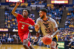 Dec 1, 2018; Morgantown, WV, USA; West Virginia Mountaineers forward Esa Ahmad (23) drives baseline past Youngstown State Penguins guard Jelani Simmons (2) during the second half at WVU Coliseum. Mandatory Credit: Ben Queen-USA TODAY Sports