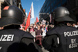 Berlin, Germany. 7th May 2016. Pro-refugee demonstrators stage counter protest against far-right demonstrators . Far-right protesters were demonstrating against islam, refugees and Angela Merkel in Mitte Berlin. Protestors demanded that Chancellor Angela Merkel stand down because of allowing large numbers of refugees and migrants to enter Germany.
