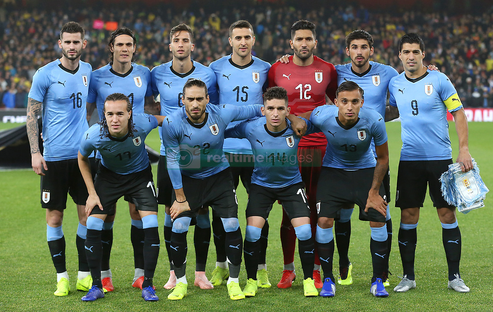 Back row, left to right, Uruguay's Gaston Pereiro, Edinson Cavani, Rodrigo Bentancur, Matias Vecino, Martin Campana, Bruno Mendez and Luis Suarez. Front row, left to right, Diego Laxalt, Martin Caceres, Lucas Torreira and Mathias Suarez