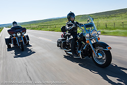Teri King, a realtor from Nebraska, on her Heritage Softail riding from Steamboat Springs to Doc Holliday's Harley-Davidson in Glenwood Springs during the Rocky Mountain Regional HOG Rally, Colorado, USA. Thursday June 8, 2017. Photography ©2017 Michael Lichter.