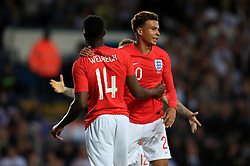 England's Danny Welbeck (left) and England's Delle Ali celebrate after the final whistle during the International Friendly match at Elland Road, Leeds.
