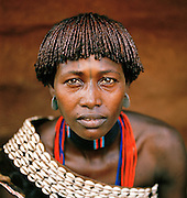 Hamer tribeswoman traditionally dressed with ochre tresses in her hair, known as goscha, Turmi, Lower Omo Valley, Ethiopia
