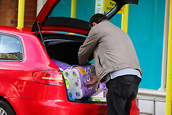 © Licensed to London News Pictures. 31/10/2020. London, UK. A shopper puts the toilet rolls in his car, in north London as panic buying begins. Prime Minister Boris Johnson has met his Cabinet this afternoon ahead of a press conference at 5pm, amid reports that the government is poised to impose a second national lockdown in England from Wednesday.  Photo credit: Dinendra Haria/LNP