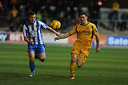 Newport's Conor Washington breaks away from Michael Duckworth.  Skybet football league two match, Newport county v Hartlepool Utd at Rodney Parade in Newport , South Wales on Friday 15th November 2013. pic by Andrew Orchard, Andrew Orchard sports photography,