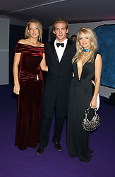 Left to right, EMILY CROMPTON, JACOBI ANSTRUTHER-GOUGH-CALTHORPE and HANNAH SANDLING at The British Red Cross London Ball - H2O The Element of Life, held at The Room by The River, 99 Upper Ground, London SE1 on 17th November 2005.<br /><br />NON EXCLUSIVE - WORLD RIGHTS