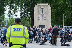 © Licensed to London News Pictures; 13/06/2020; Bristol, UK. Protestors at an 'All Lives Matter' rally stand guard at the Cenotaph war memorial in Bristol city centre, alongside bikers. At the event there were scuffles and a black man appeared to get punched in the face and was led away by police. The 'All Lives Matter' rally comes nearly a week after the Black Lives Matter march when the statue of Bristol slave trader and philanthropist Edward Colston was pulled down from a plinth nearby and thrown into Bristol harbour. Despite the restrictions due to the Covid-19 coronavirus pandemic, Black Lives Matter protests have occurred across the world in memory of George Floyd, a black man who was killed on May 25, 2020 in Minneapolis in the US by a white police officer kneeling on his neck for nearly 9 minutes. Photo credit: Simon Chapman/LNP.